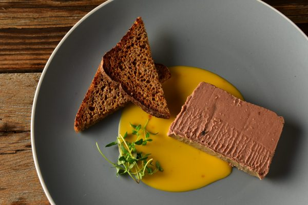 a slice of duck and orange pate